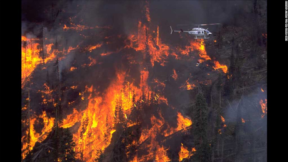Greer's third-place image is of a helitorch being used on the Mad Creek Fire in Medicine Bow-Routt National Forests in Colorado.