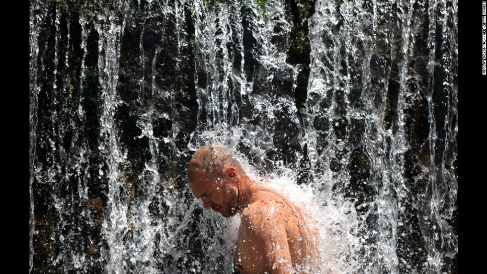 A Bulgarian man cools off in a waterfall Thursday during a heat wave, near the town of Blagoevgrad. Temperatures in Bulgaria reached 99 degrees Fahrenheit.