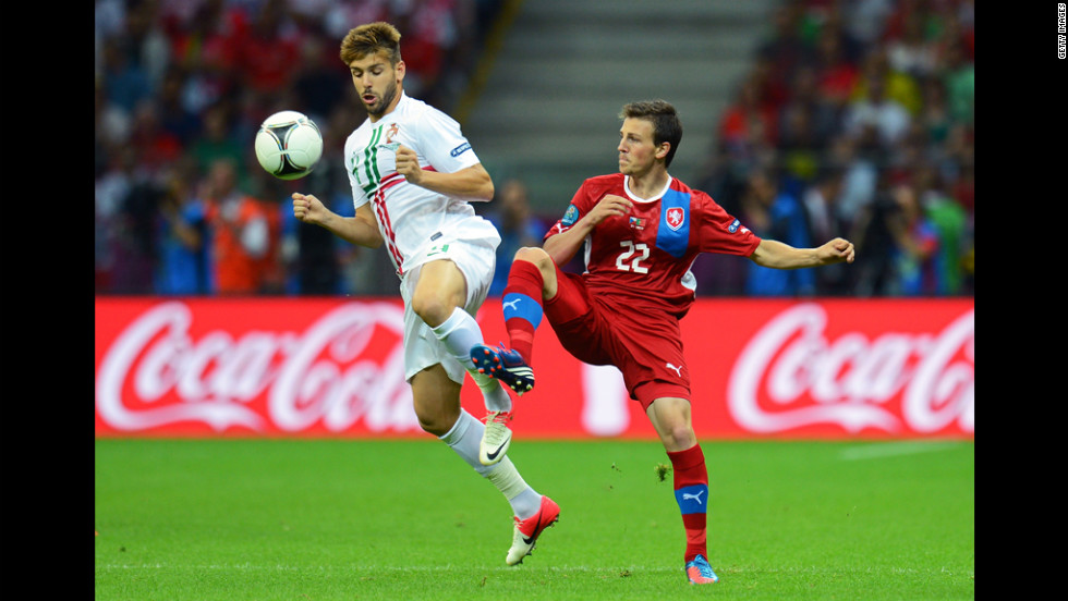 Miguel Veloso of Portugal and Vladimir Darida of Czech Republic battle for the ball during the quarter-final match between Czech Republic and Portugal.