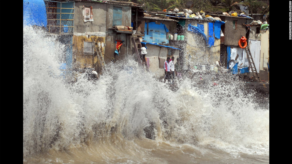 Sea shore dwellings in Mumbai, India, are battered by a high tide driven by strong winds Thursday.