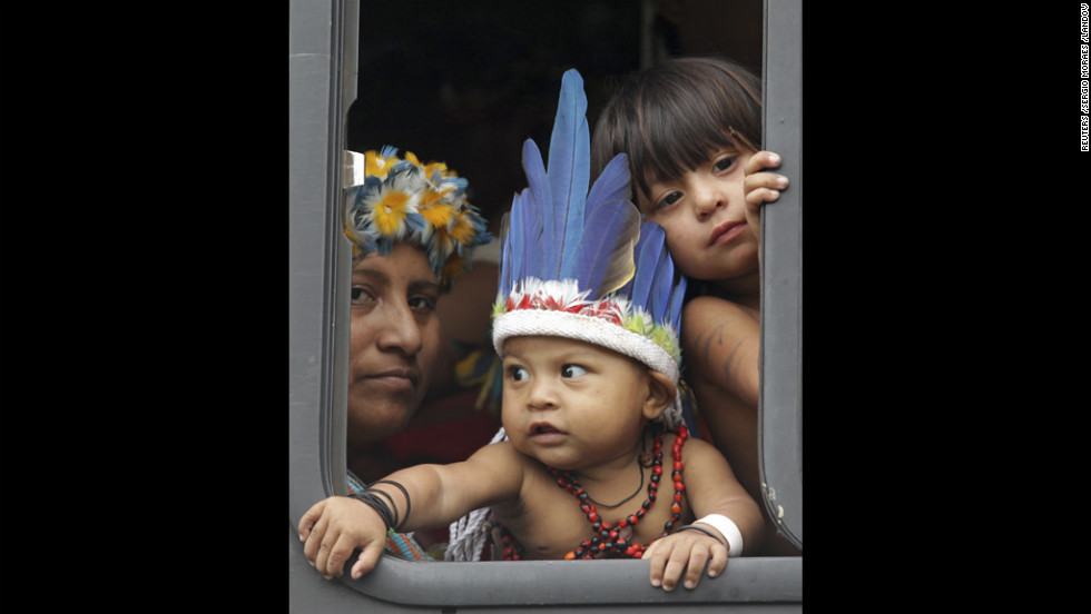 Indigenous people arrive at a meeting by bus Thursday during the Rio+20 United Nations Conference on Sustainable Development in Rio de Janeiro, Brazil.