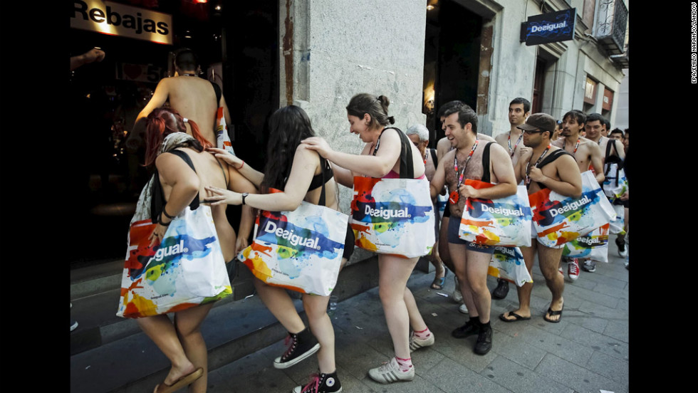 Customers enter a Madrid, Spain, shop that offered free clothes to the first 100 people in line wearing nothing but their underwear on Thursday, the shop's first day of sales.