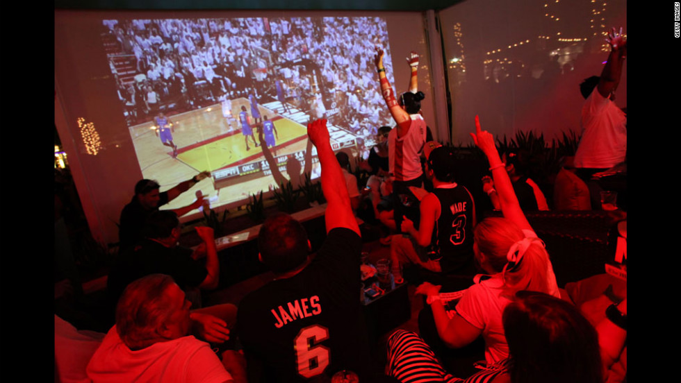 Fans watch game five of the 2012 NBA finals between the Oklahoma City Thunder and Miami Heat at Havana Nines in Miami.