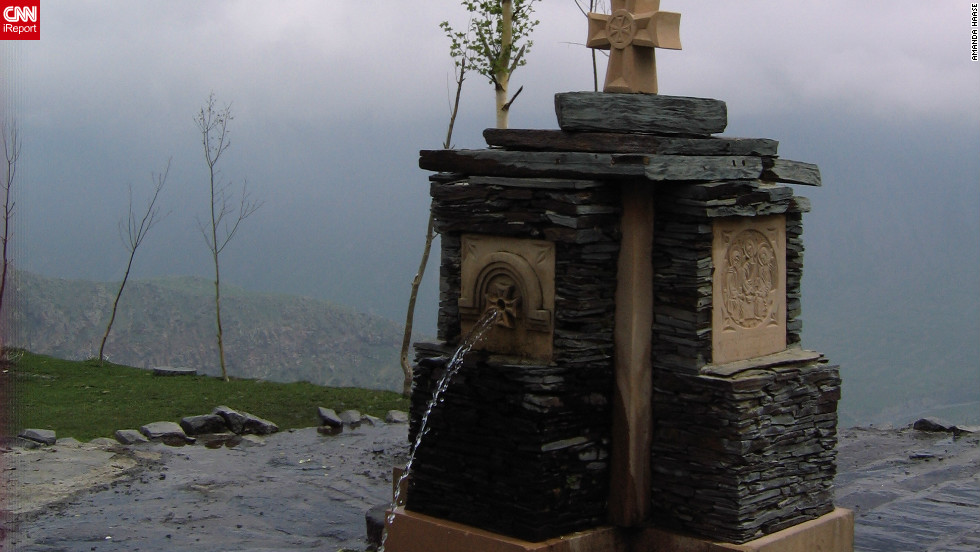 "This photo of a cross fountain high above the mountains near Georgia's border with Russia was taken by Amanda Haase. The graduate student from Washington D.C. was visiting the country in 2011 as part of a research project on relations between the two countries. ""The rainy day made the clouds low and gave some really interesting light to the fountain,"" she says."