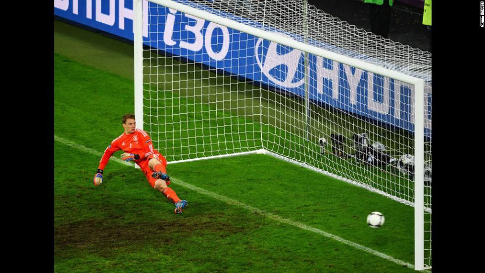 Manuel Neuer of Germany dives the wrong way as Dimitris Salpigidis of Greece (not pictured) scores from the penalty spot during the quarterfinal match between Germany and Greece.