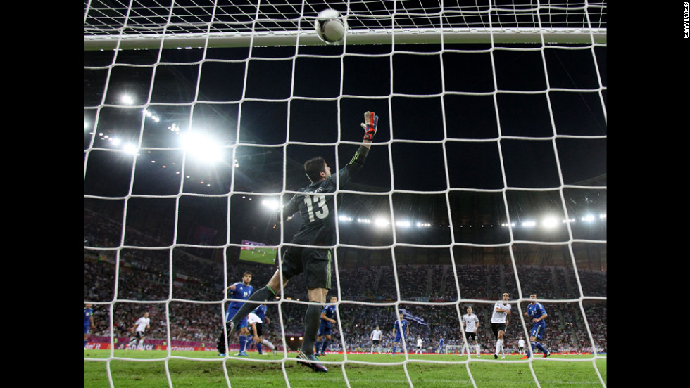 Sami Khedira of Germany scores the team's second goal past Michalis Sifakis of Greece.
