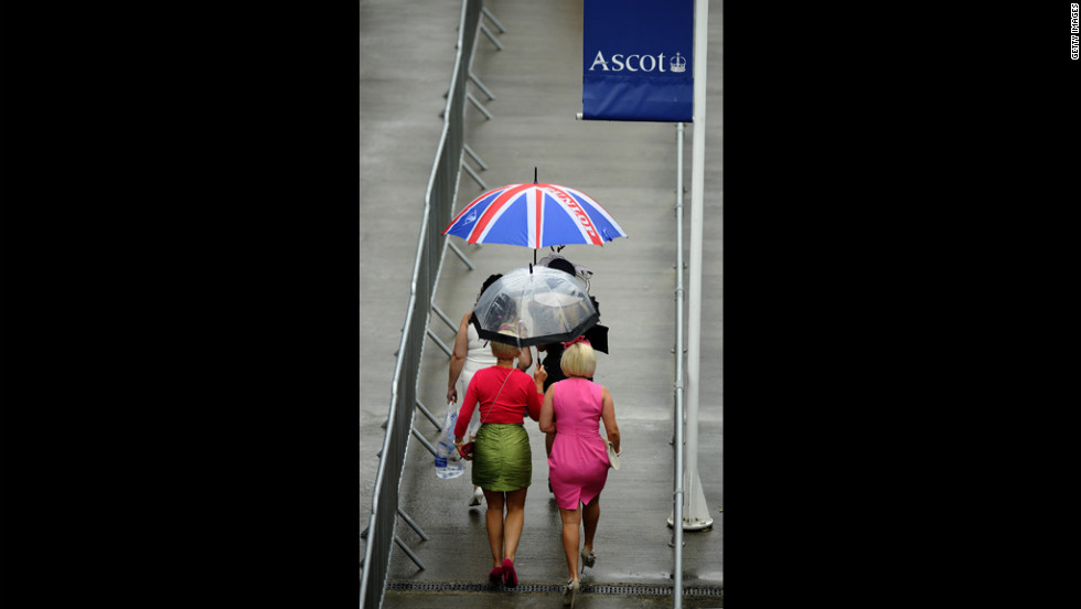 Rain falls on the race-goers attending the Royal Ascot.
