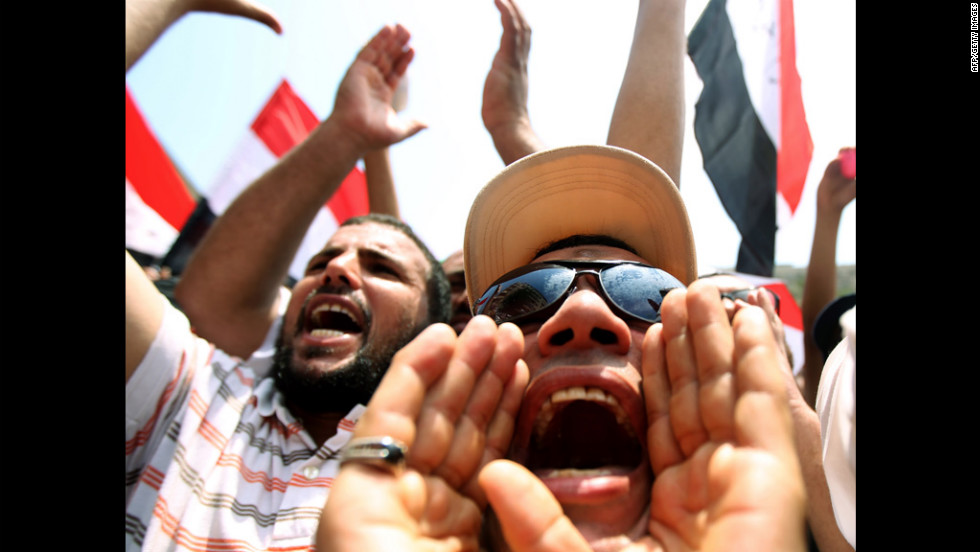 Protesters shout slogans to denounce what they claim is a power grab by the ruling military, as the nation nervously awaits the results of the first post-Mubarak presidential election.