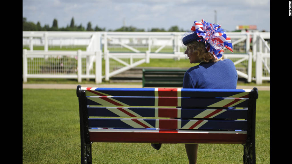 A race-goer attends day five of the Royal Ascot races in Ascot, England, on Saturday, June 23.