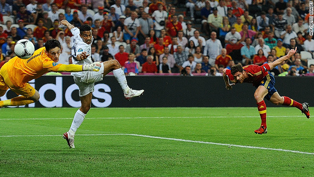 Xabi Alonso (right) heads past goalkeeper Hugo Lloris to open Spain's account in the quarterfinal against France on Saturday