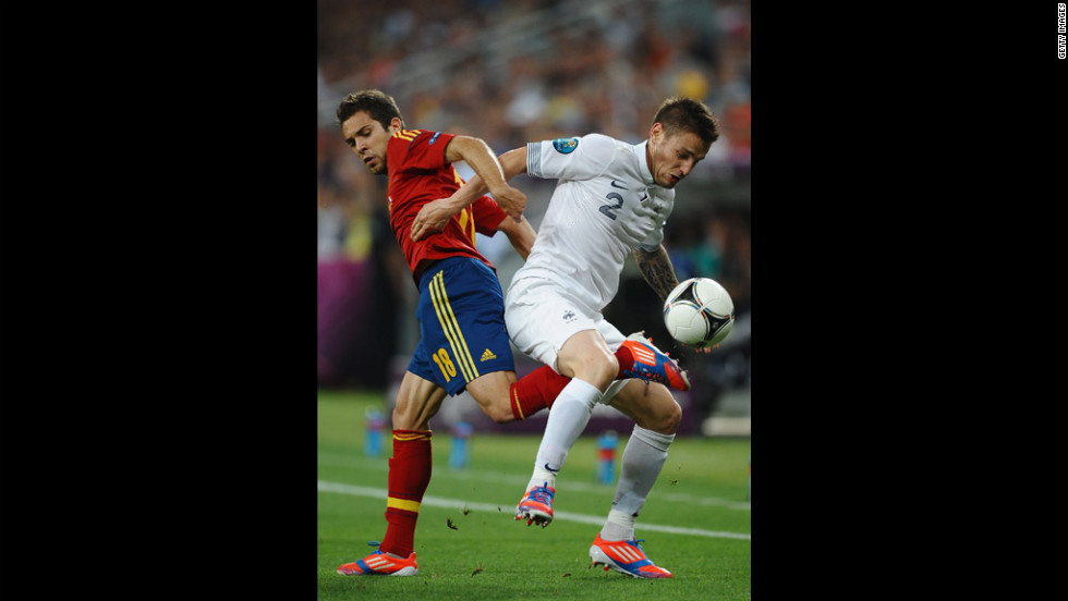 Jordi Alba of Spain in action with Mathieu Debuchy of France.