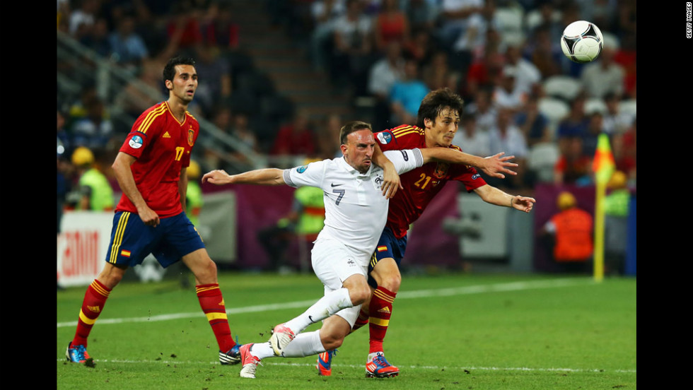 Franck Ribery of France and David Silva of Spain challenge for the ball.