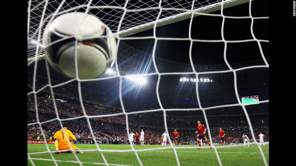 Xabi Alonso of Spain scores the second goal from the penalty spot during the quarter final match between Spain and France.