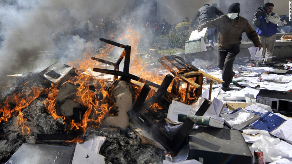 Protesters raided police intelligence offices, seizing computers and burning investigation documents on June 22, 2012. Protesters threw rocks while others burned papers, furniture and other items in the street