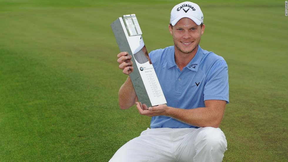 European Tour star Danny Willett, pictured with the BMW International Open trophy in Cologne.