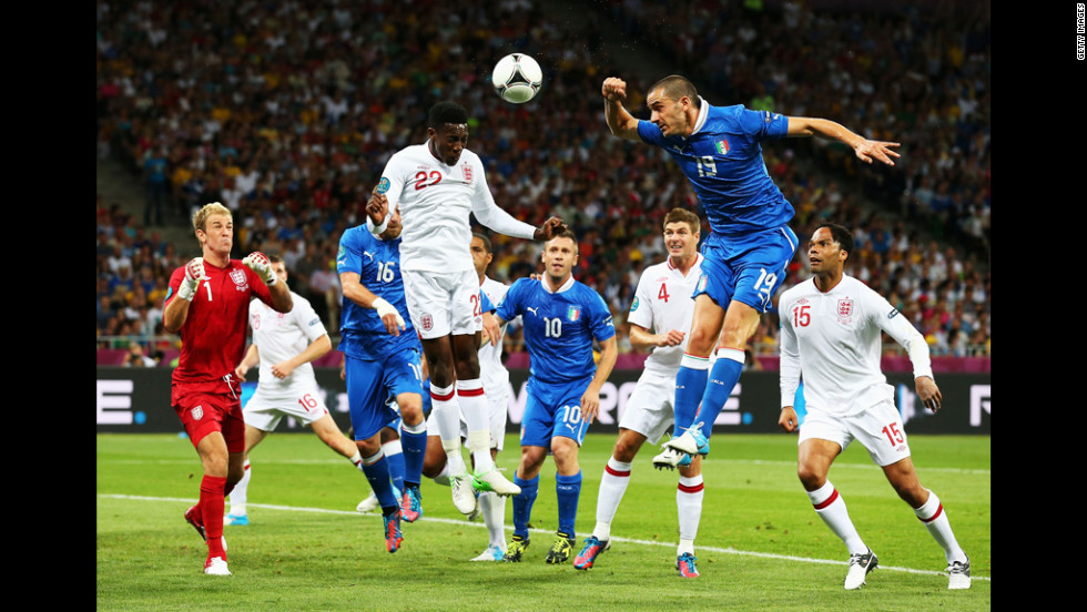 Danny Welbeck of England and Andrea Barzagli of Italy jump for the ball.