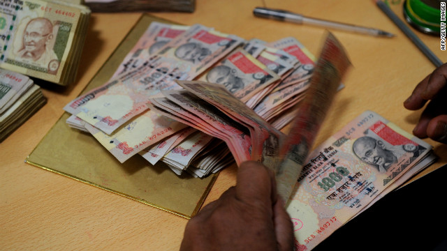 A bank employee counts Indian rupee notes at a bank in Mumbai on May 16, 2012.