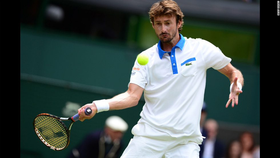 Spain's Juan Carlos Ferrero plays a forehand shot during his first round men's singles match against Serbia's Novak Djokovic.