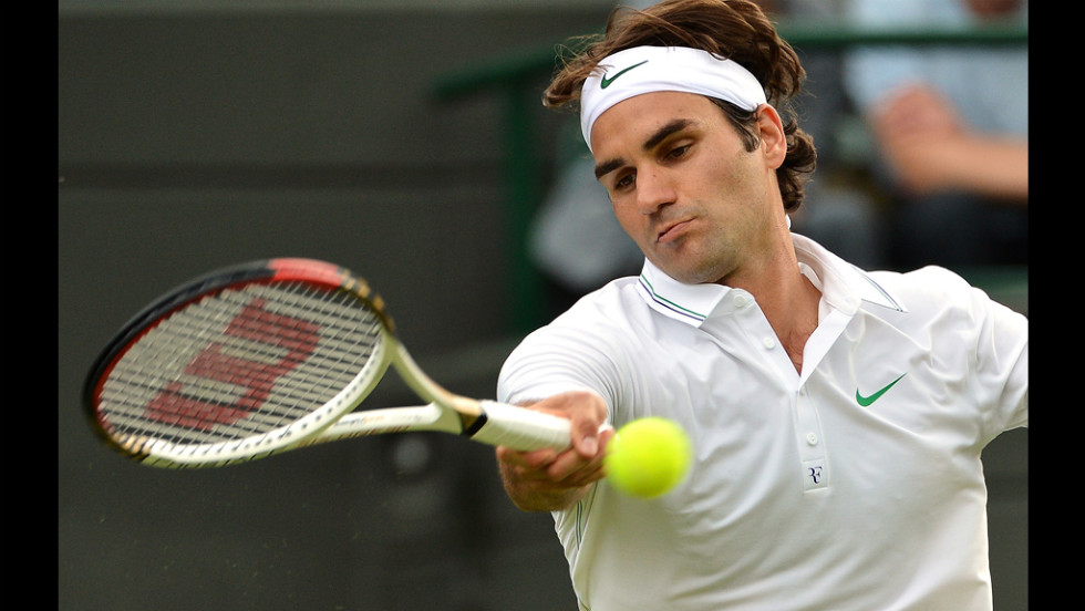 Switzerland's Roger Federer plays a forehand shot during his first round men's singles match against Spain's Albert Ramos.