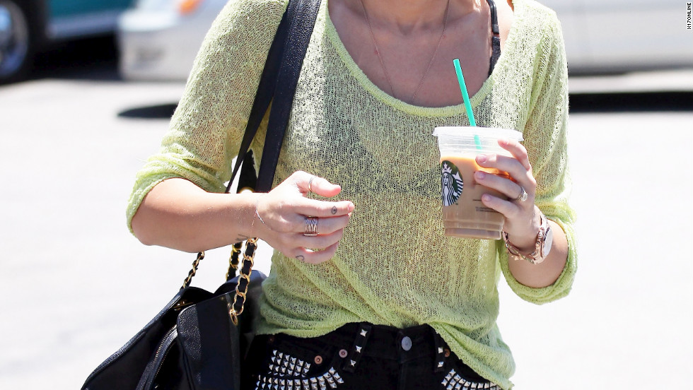 Miley Cyrus grabs coffee with a friend in Studio City.