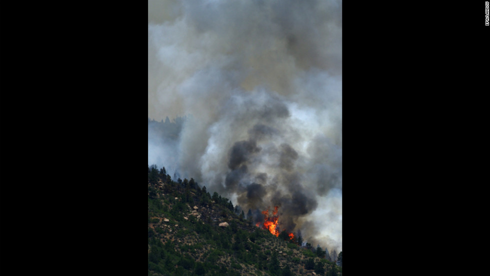 A portion of the Waldo Canyon fire burns out of control in the hills west of Manitou Springs on Monday.