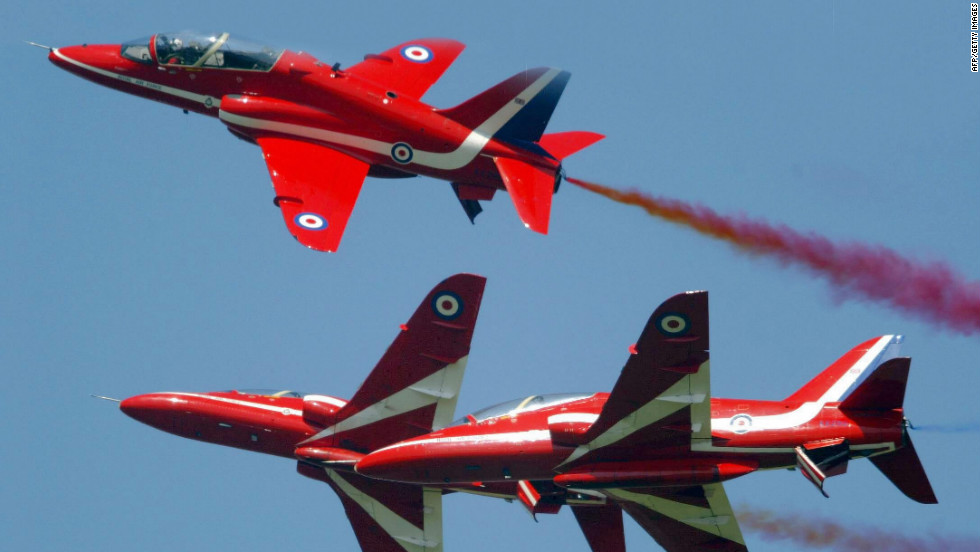 "Members of the British Royal Airforce's ""Red Arrows"" aerial display perform stunts over Farnborough in 2004."