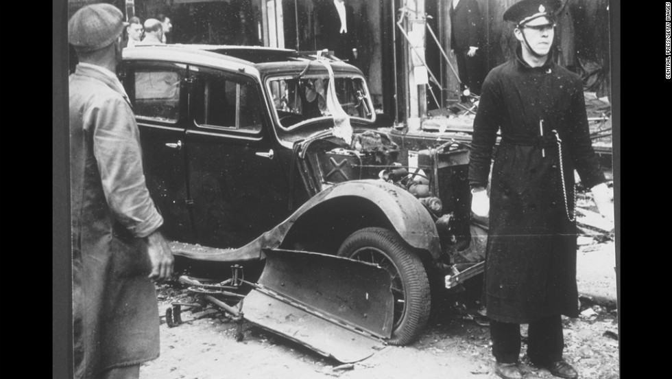 A car sits in rubble at the scene of an IRA bombing in Coventry, England, in 1939. The bomb was planted in the basket of a tradesman's bicycle and killed five people.