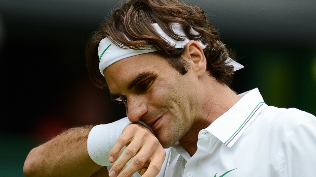 Roger Federer hardly had to break sweat as he cruised past Italy's Fabio Fognini on day three at Wimbledon.