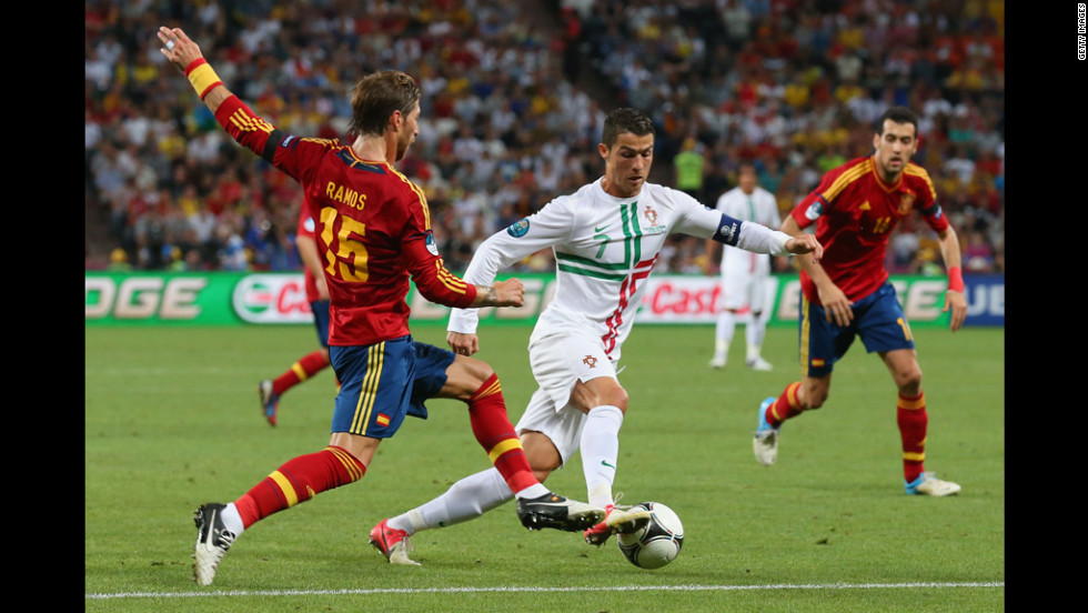 Sergio Ramos of Spain challenges Cristiano Ronaldo of Portugal