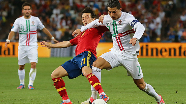 David Silva of Spain competes with Cristiano Ronaldo of Portugal during the Euro 2012 semi-final match at Donbass Arena