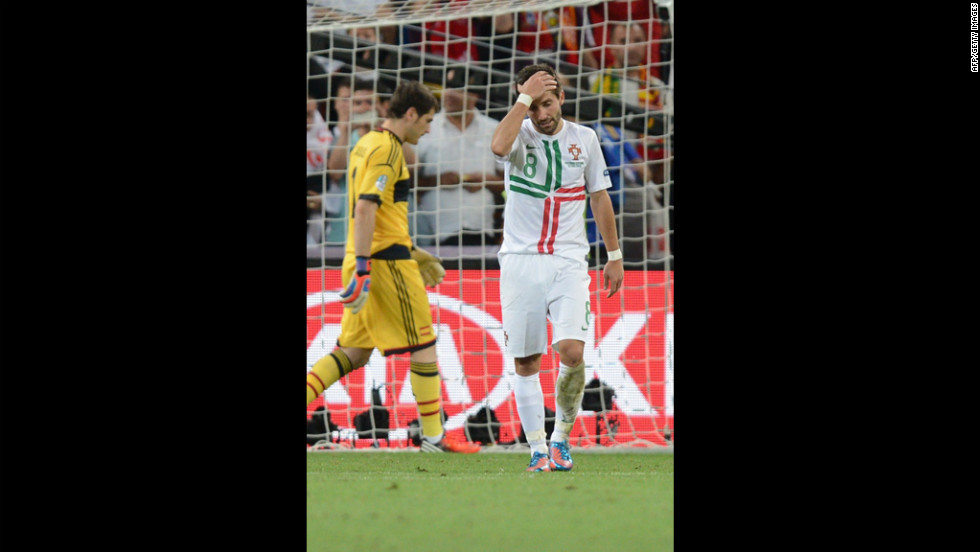 Portuguese midfielder Joao Moutinho reacts after he fails to score a penalty shot against Spanish goalkeeper Iker Casillas.