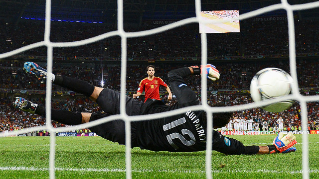 Spain's Cesc Fabregas scores the decisive penalty past Portugal's Rui Patricio in Donetsk