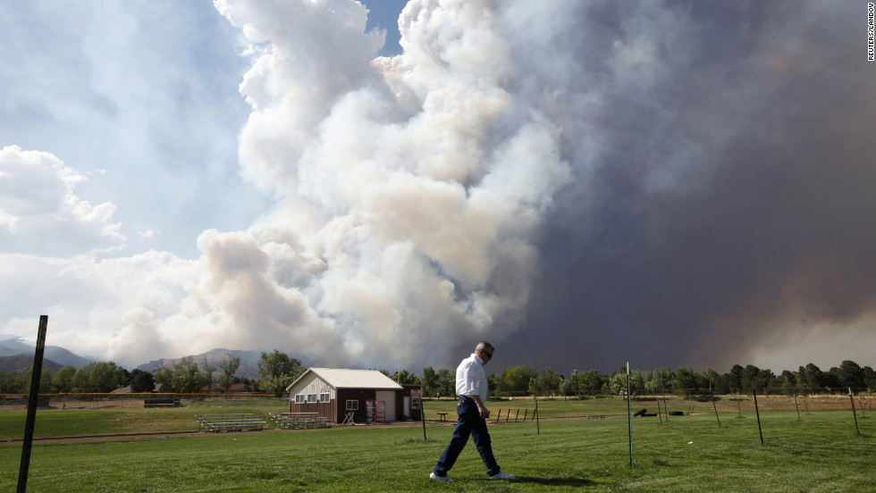 A large plume of smoke from the Waldo Canyon Fire fills the sky west of Colorado Springs on Tuesday.