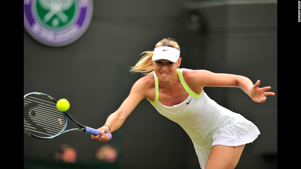 Russia's Maria Sharapova returns a shot to Tsvetana Pironkova of Bulgaria on June 28.