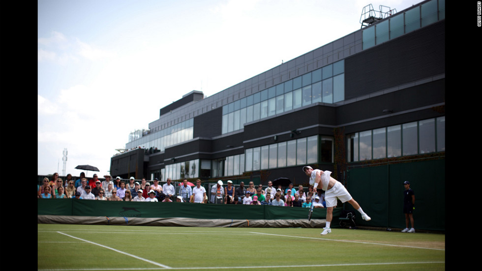 Jesse Levine of the United States serves against Belgium's David Goffin on day four of the Wimbledon championships on June 28.