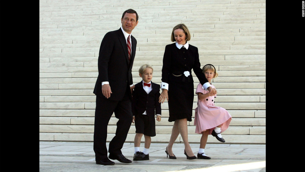 After taking the Supreme Court bench for the first time, Chief Justice Roberts leaves with his wife, Jane, and their children, Jack and Josie, on October 3, 2005.