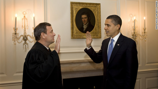Chief Justice John Roberts re-administers the oath of office to Barack Obama at the White House on January 21, 2009.