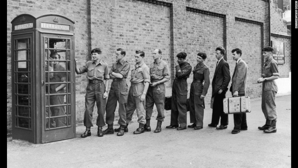 Here English troops call their loved ones in 1956 after being told to prepare for duty in the Suez Canal Zone. Payphones were common until cell phones became popular and affordable.