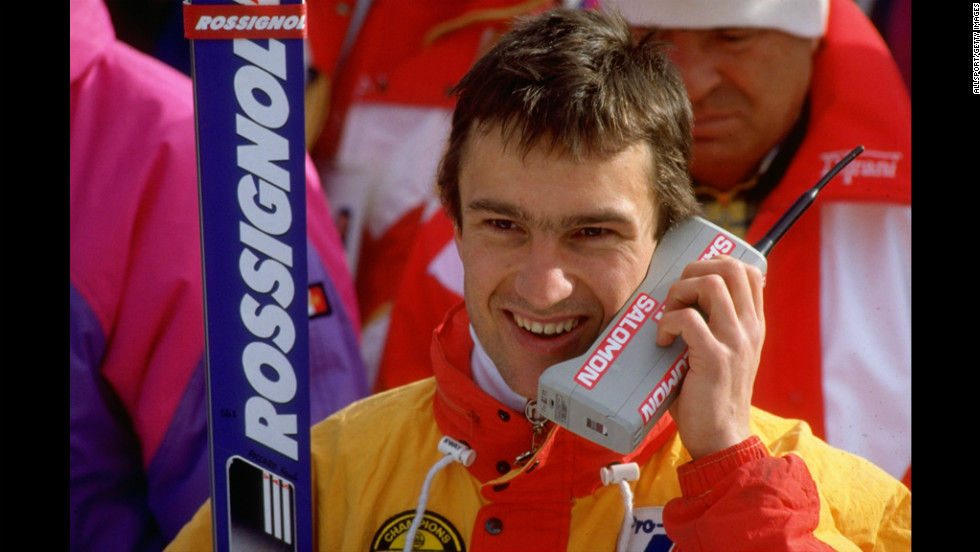 French skier Franck Piccard talks on his mobile phone after an event at the 1988 Winter Olympic Games in Calgary, Alberta, Canada.