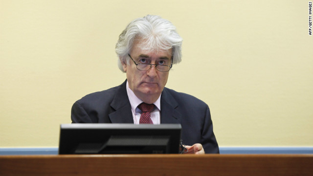 Former Bosnian Serb leader Radovan Karadzic looks up during his first court appearance since the start of his genocide trial in the courtroom of the International Criminal Tribunal for the former Yugoslavia (ICTY) in the Hague on November 3, 2009.Karadzic has refused to leave his jail cell since the trial started on October 26, saying he needs more time to review more than a million pages of prosecution evidence and the statements of hundreds of witnesses. He is charged with 11 counts of genocide, war crimes and crimes against humanity for his role in the 1992-95 Bosnian war that claimed some 100,000 lives and caused 2.2 million people to flee their homes. AFP PHOTO / ANP PHOTO / Michael Kooren netherlands out - belgium out (Photo credit should read MICHAEL KOOREN/AFP/Getty Images)