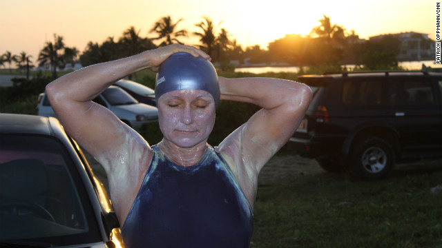 Australian Penny Palfrey, coated with sunblock, takes a deep breath before diving into the ocean.