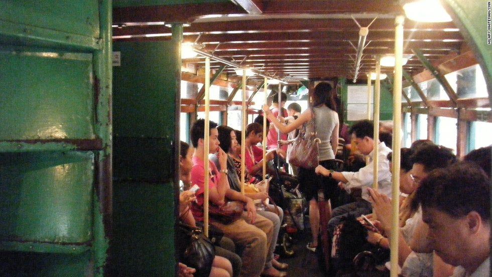 Hong Kong commuters on an old-fashioned tram during the morning commute in the city center. The Special Administrative Region of China marks 15 years on July 1 since it moved from British to Chinese rule.