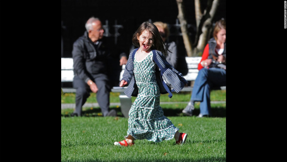 Suri Cruise, the daughter of Tom Cruise and Katie Holmes, plays in the Charles River Basin on October 10, 2009, in Cambridge, Massachusetts. Holmes and Cruise were married in November 2006 after Suri, their only child, was born in April of that year.