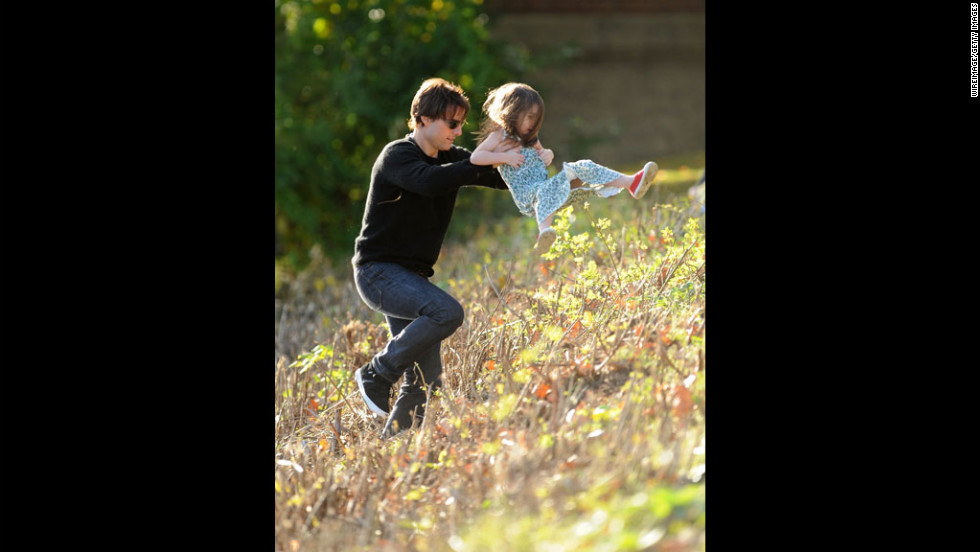 "Cruise plays with Suri in Cambridge on October 10, 2009. Cruise's lawyer said the actor ""is very sad about [the divorce] and is concentrating on the kids."""