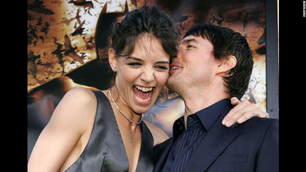 "Holmes and Cruise cuddle up on the red carpet for the ""Batman Begins"" premiere at Grauman's Chinese Theater in Hollywood in 2005."