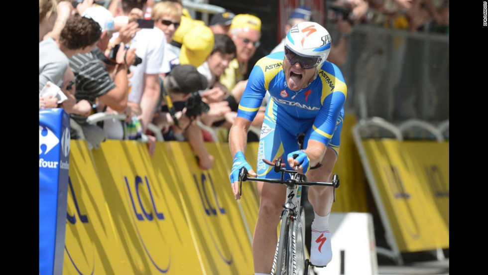 Andriy Grivko of Ukraine grimaces as he nears the finish line during the time trial, cheered on by fans.