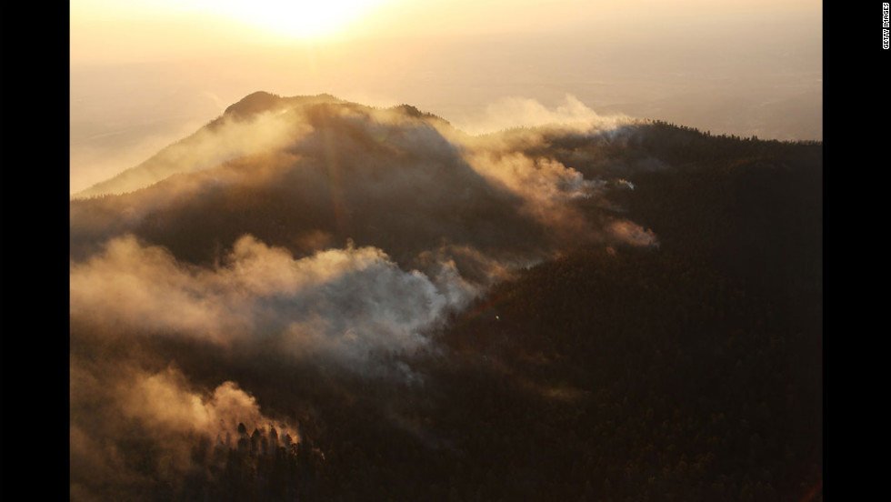 Smoke billows at sunrise from part of the Waldo Canyon fire in Colorado Springs.