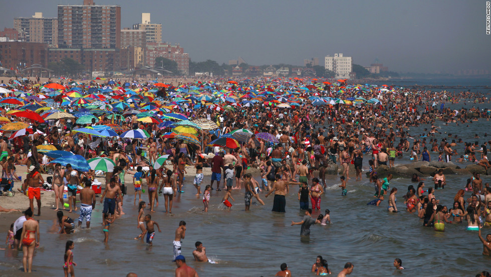 Residents crowd onto the beach at Coney Island in  Brooklyn, New York, in the powerful heat on Saturday.