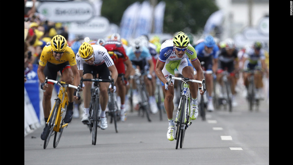 Peter Sagan of Slovakia, right, sprints to victory at the Stage 1 finish line Sunday ahead of Fabian Cancellara of Switzerland, left, and Edvald Boasson Hagen of Norway, center.