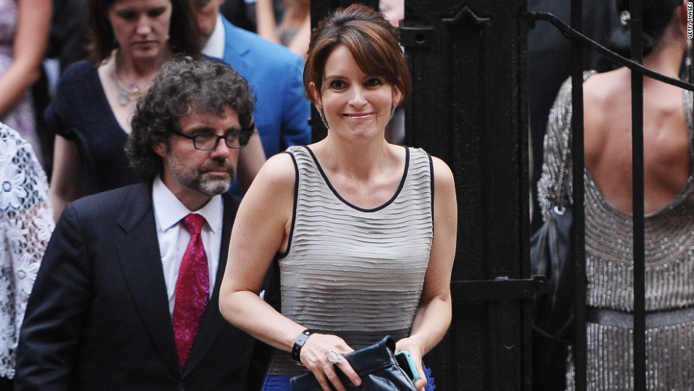 "Tina Fey, who co-stars with Baldwin on ""30 Rock,"" arrives with her husband, Jeff Richmond."
